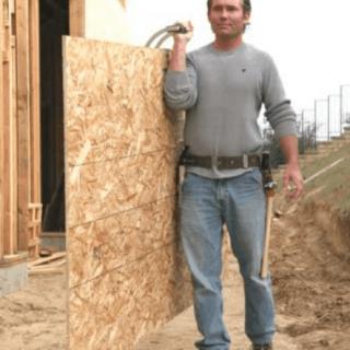 Man using Plywood sheet carrier